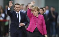 Меркель и Макрон приветствуют изменения в реализации минских соглашений