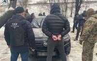 Запугивали и вымогали деньги у граждан: СБУ заблокировала в Днепре деятельность банды Арийца