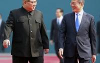 Лидеры двух Корей прогулялись и посадили дерево мира