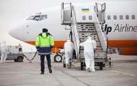 Эвакуация украинцев из Уханя: видео из салона самолета