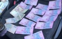 Полицейские вымогали взятку и шантажировали уголовным производством