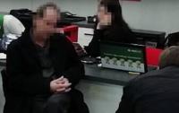 Кредитные мошенники: в Днепре задержали аферистов с чужими документами
