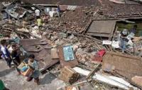 Число жертв прорыва плотины в Индонезии увеличилось