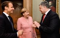 Порошенко назвал главную цель переговоров с Меркель и Макроном