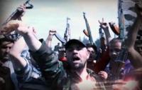 Власти Сирии обвиняют повстанцев в массовых убийствах в Хуле