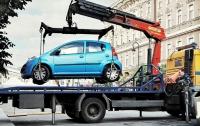 В Киеве будут эвакуировать авто, припаркованные на люках