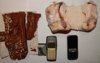 В Полтаве заключенному пытались передать телефон в сале