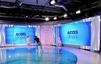 На телеведущую в прямом эфире набросилась обнаженная женщина с камнем в руках (видео)