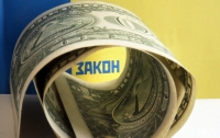 Полицейский под Киевом требовал взятку за возвращение владельцу автомобиля