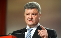 За порванный портрет Порошенко активисту могут дать 7 лет