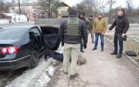 СБУ разоблачила банду торговцев оружием, организованную полицейским