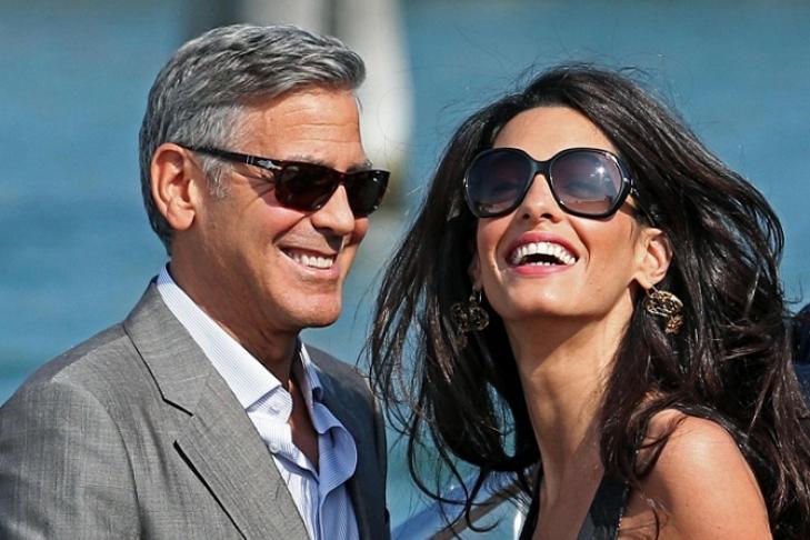 Джордж Клуни с супругой приехал наВсемирный экономический форум вДавосе