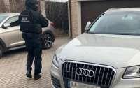 Киевляне организовали международную мошенническую схему. Их арестовали с залогом в 325 млн грн