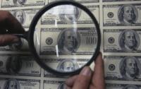 В Днепре скупали смартфоны за фальшивые доллары
