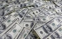 Украину наводнили фальшивые доллары, которые принимают банкоматы